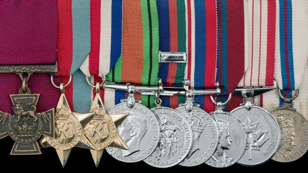 The Victoria Cross, left, is among nine medals awarded to Lt.-Col. David Currie that were put up for auction.