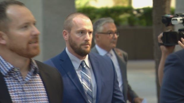 York Regional Police Const. Michael Partridge exits a Toronto court after being granted a conditional discharge of his assault charge on Sept. 27.