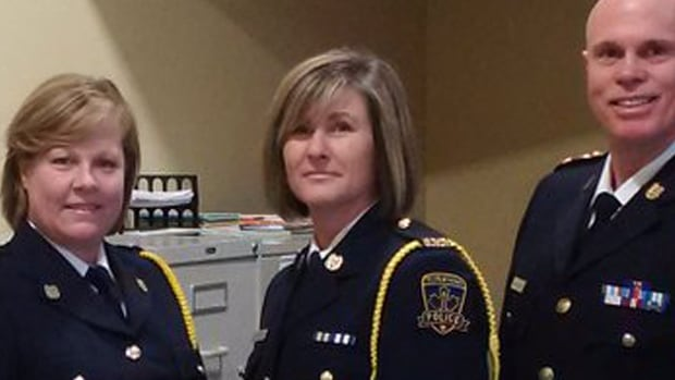 Julia Cecchetto (centre) has been hired as the new chief of the Kentville Police Service. She's the first woman to be named chief of a Nova Scotia police force.