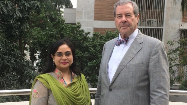 Douglas Stanley stands outside the International Labour Organization office in Bangladesh with Noushin Safinaz Shah, project officer for the organization in Dhaka.