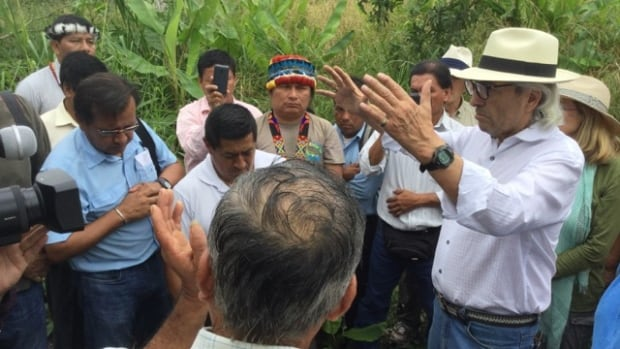 Phil Fontaine, right, speaks to Indigenous leaders in Ecuador Wednesday.