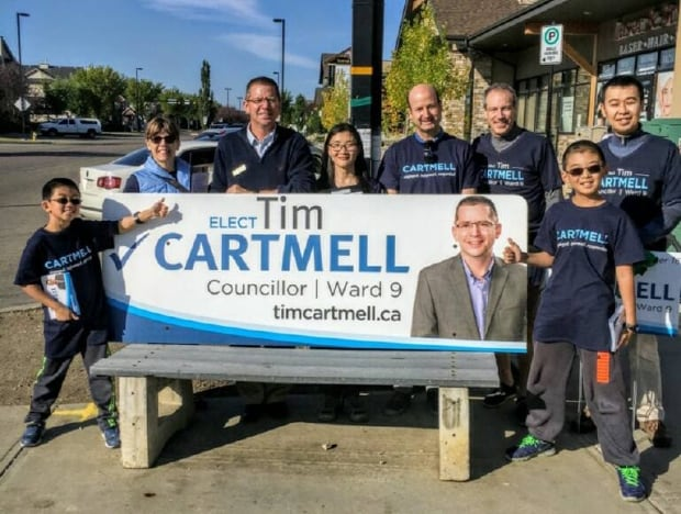 Tim Cartmell (third from the left) stands with his supporters (Facebook)