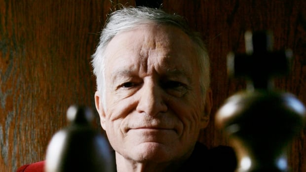 Hugh Hefner poses at the Playboy Mansion in Los Angeles in 2007. Playboy released a statement saying Hefner died at his home in Los Angeles of natural causes on Wednesday, surrounded by family.