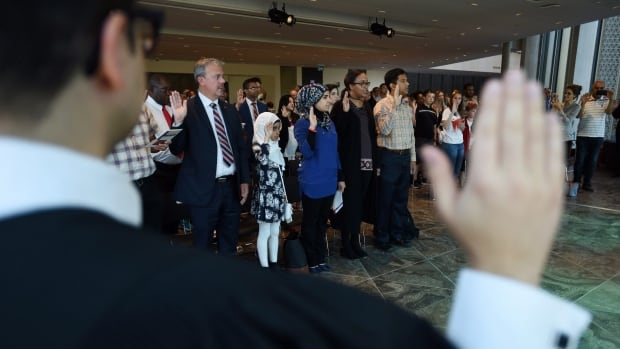 Newcomers to Canada take the oath of citizenship at the National Arts Centre in Ottawa on Sept. 25. Proposed new text for the oath was put to focus groups held by Immigration, Refugees and Citizenship Canada in March.