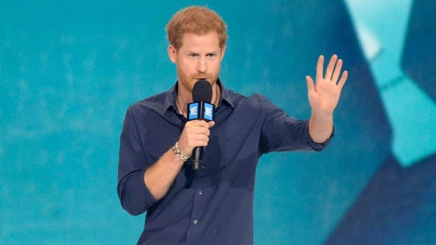 Stop, thief! Prince Harry catches toddler 'stealing' his popcorn