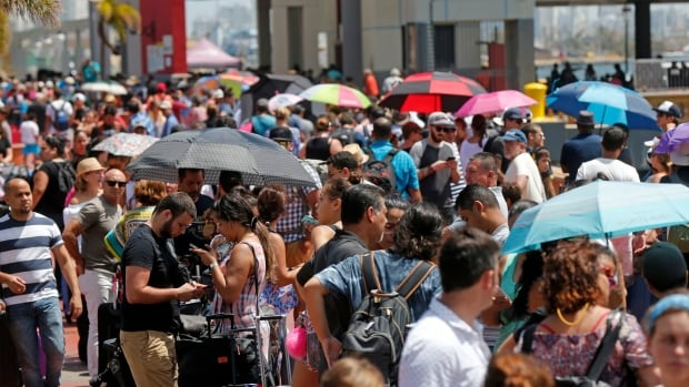 Thousands of people evacuating Puerto Rico line up to get on a cruise ship in the aftermath of Hurricane Maria in San Juan, Thursday, Sept. 28, 2017.