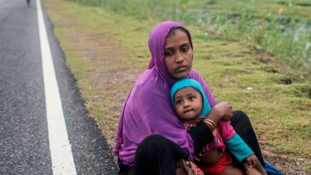 Rohingya Muslim refugees wait on a road in Bangladesh's Ukhia district on Wednesday. Some half a million Rohingya Muslims have fled Myanmar amid violence the United Nations has branded ethnic cleansing.
