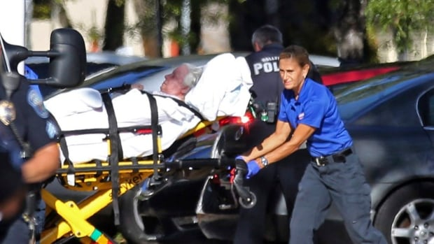 A woman is transported from the Rehabilitation Center at Hollywood Hills on Sept. 13 as patients are evacuated after a loss of air conditioning due to Hurricane Irma in Hollywood, Fla.