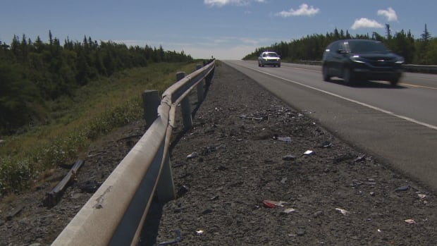 Debris remains on the roadside following a devastating head-on collision on the Trans-Canada near the turnoff to Bellevue, Trinity Bay on Aug. 27. Four people died, including a husband, wife and their young son.