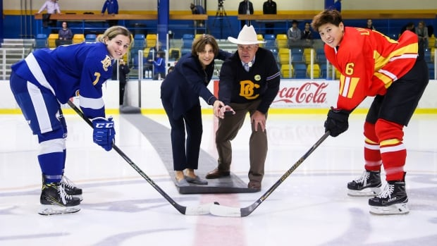 China's head of female high performance Digit Murphy helps to drop the puck as UBC takes on China in an exhibition game. Murphy, an American, has been hired to to speed the development of the game in China.