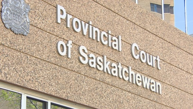 A man has been charged in connection with the apparent overdose of three men being held in custody at Regina provincial court in August.