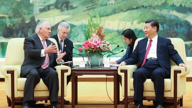 U.S. Secretary of State Rex Tillerson, left, meets with Chinese President Xi Jinping  at the Great Hall of the People on Saturday in Beijing.