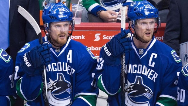 The Vancouver Canucks may have to put their rebuild on hold for another year as they will have to fork over $7 million US to each of Daniel and Henrik Sedin, right, and most likely rely on the duo to log big minutes.