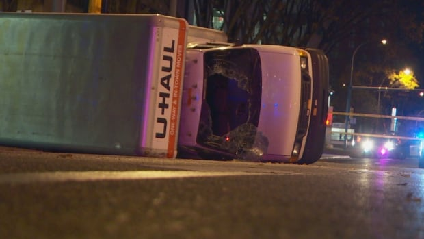 A U-Haul lies on its side near 100th Avenue and 107th Street, after a high-speed chase with Edmonton police.