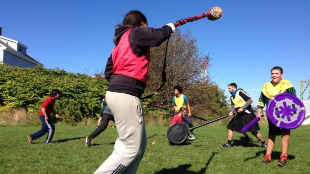 "Lauren Oliver swings a weapon called ""the chain"" towards teammate Jacob Brennan during a Halifax Jugger League practice on Oct. 1."