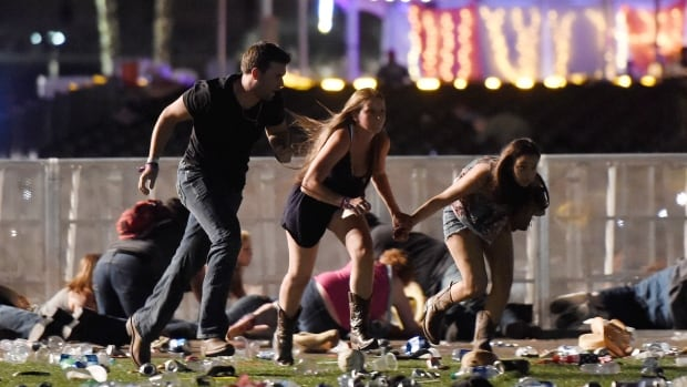 People from the Route 91 Harvest country music festival in Las Vegas run after a man opened fire, leaving at least 50 people dead and more than 400 injured.