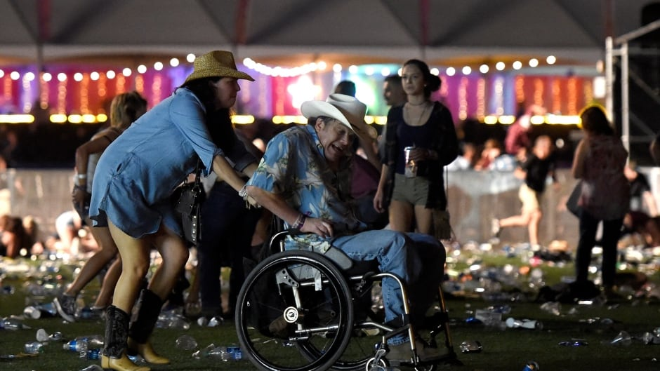 A man in a wheelchair is taken away from the Route 91 Harvest country music festival after apparent gun fire was heard on October 1, 2017 in Las Vegas, Nevada.  There are reports of an active shooter around the Mandalay Bay Resort and Casino. (David Becker/Getty Images)