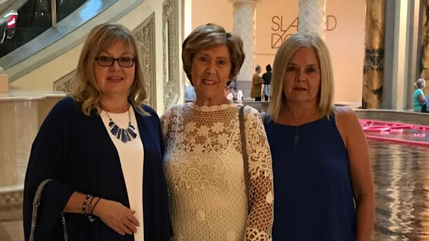 From left, Kim Ramier, Lou Cummings and Kathy Saunders at Caesars Palace in Las Vegas on Saturday evening. The next night, Cummings and Saunders turned down tickets to a festival where crowds were targeted in a mass shooting.