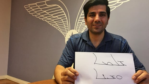 Ashor Sworesho shows an Assyrian greeting and response wishing the person peace. The Assyrian language is written from right to left.