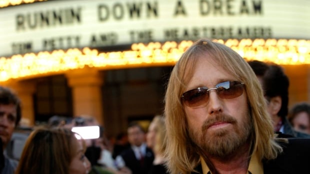 """In this Oct. 2, 2007 file photo, singer Tom Petty arrives at the world premiere of the documentary """"Runnin' Down a Dream: Tom Petty and the Heartbreakers"""" in Burbank, Calif. Petty has died at age 66. (AP Photo/Chris Pizzello, File)"""