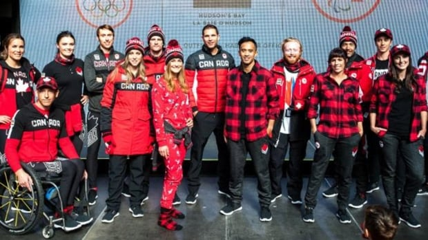 Fifteen of Canada's hopefuls for the PyeongChang Winter Games in February took to the runway at Toronto's Eaton Centre on Tuesday dressed in the patriotic red-white-and-black apparel that will be worn for the opening and closing ceremonies.