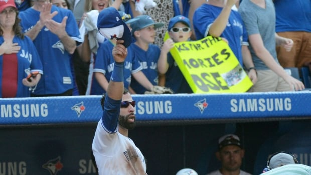 Jose Bautista acknowledges the Rogers Centre crowd during his final home game as a Blue Jay on Sept. 24.