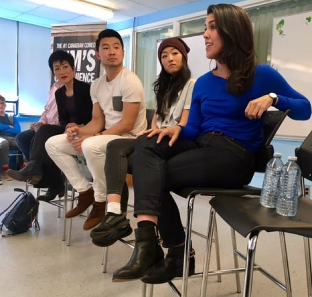 Kim's Convenience star Nicole Power, right, of Logy Bay-Middle Cove-Outer Cove, chats with students from her old high school.(Jeremy Eaton/CBC)