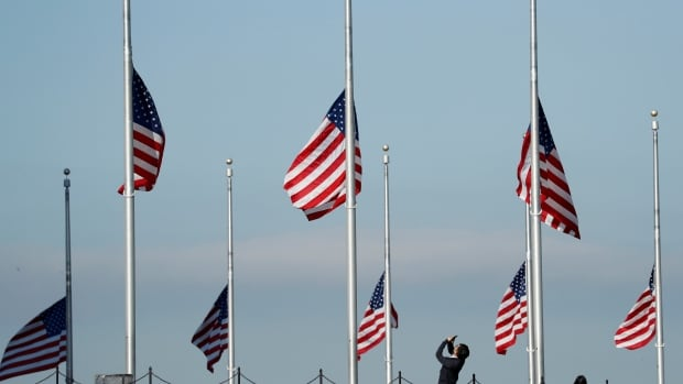 Flags are at half staff to honour those killed and injured in the Las Vegas mass shooting at the Washington Monument in Washington, U.S., October 3, 2017.
