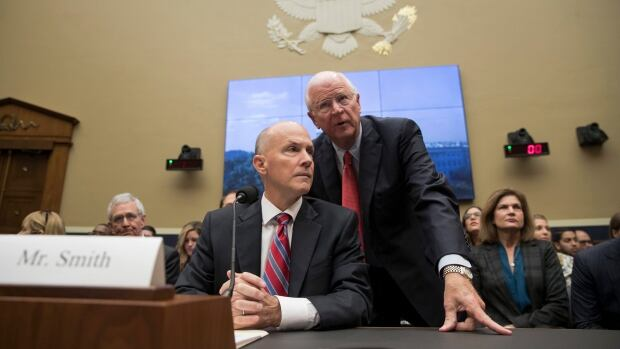 Former chairman and CEO of Equifax Richard F. Smith, talks with former Sen. Saxby Chambliss, R-Ga., as he takes his seat to testify before the Digital Commerce and Consumer Protection Subcommittee of the House Commerce Committee on Capitol Hill in Washington, Tuesday, Oct. 3, 2017. AP Photo/Carolyn Kaster)