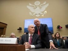 As former Equifax CEO Richard Smith testified before the Senate Banking Committee, Amanda Werner appeared in the background dressed as the Monopoly Man.