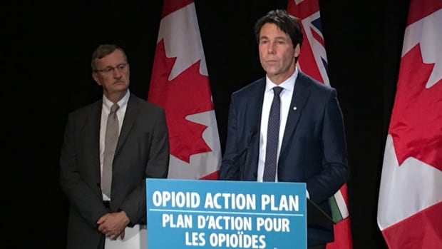 Ontario's Minister of Health Dr. Eric Hoskins, right, and Dr. David Williams, the province's chief medical officer of health, announce the new opioid emergency task force at Queen's Park on Wed., Oct. 4, 2017.