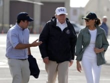 U.S. President Donald Trump talks with residents while surveying hurricane damage in San Juan, Puerto Rico, U.S., October 3, 2017.