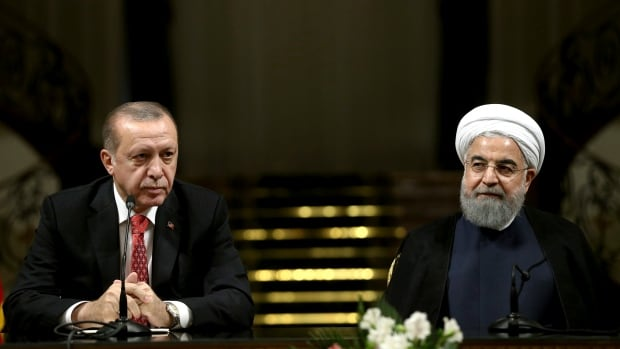 Turkish President Recep Tayyip Erdogan, left, speaks with media during a joint press conference with Iranian President Hassan Rouhani after their meeting at the Saadabad Palace in Tehran on Wednesday.