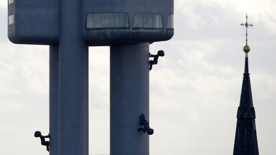 The Vitkov National Memorial in Prague shows 'the climbing babies' by artist David Cerny adorning the Zizkov TV Tower.