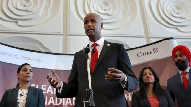 Immigration Minister Ahmed Hussen tells guests at City Hall in Brampton, Ont., Wednesday that the Liberal government's changes to citizenship laws would take effect next week.