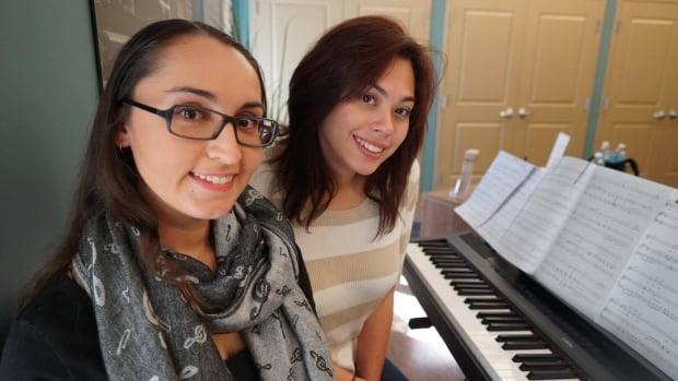 Ivy Manouchehri (left) and Kristal Daniels are two of three Western University students living rent-free at Oakcrossing Retirement Living in London Ontario in exchange for their time.