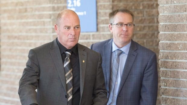Train driver Thomas Harding, left, is one of three ex-railway employees on trial in Sherbrooke, Que.