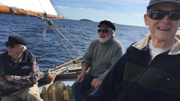 Former and present owners Chris Pelham, Harley Schofield and Francis Forbrigger sail on the schooner Wawaloon off Chester, N.S.