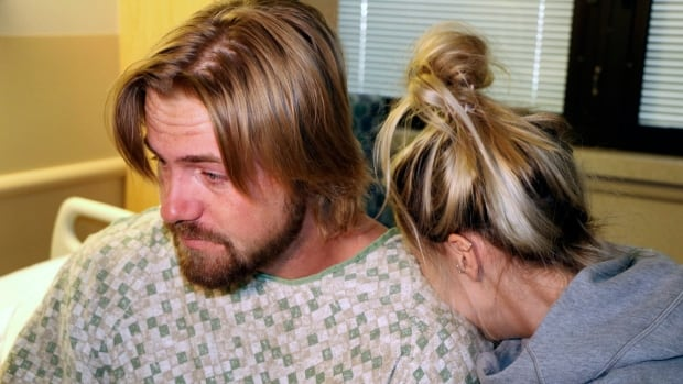 Amanda Homulos, right, hugs her boyfriend Braden Matejka at the Sunrise Hospital in Las Vegas. The B.C. couple had travelled to Las Vegas to celebrate Matejka's 30th birthday.