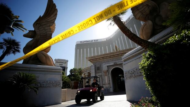 A member of the FBI leaves the Mandalay Bay hotel following the mass shooting in Las Vegas.  Police and FBI are frantically looking for information about what might have motivated gunman Stephen Paddock.