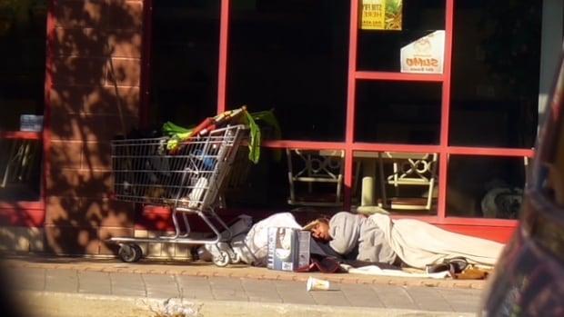 Homeless person sleeps on Maryland Street in Winnipeg