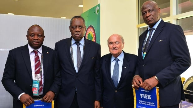 Equatorial Guinea's soccer federation president Andres Jorge Mbomio, left, is seen during the 2015 Africa Cup of Nations. The small, oil-rich country on Africa's west coast has been implicated in trying to buy success by enticing foreign players, mostly from Brazil, leading to a ban of the women's team from the 2019 World Cup.