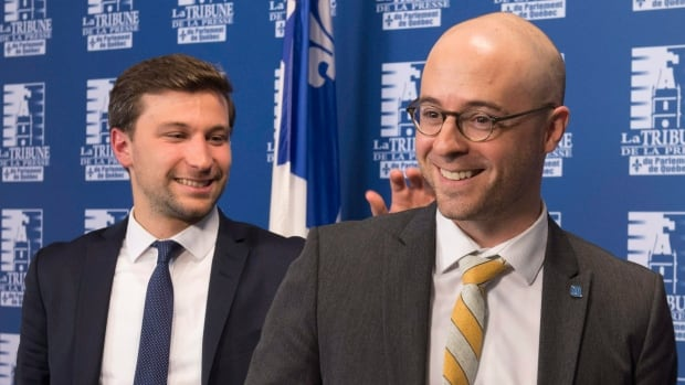Québec Solidaire co-spokesperson Gabriel Nadeau-Dubois, left, and Option Nationale leader Sol Zanetti announced their intention to merge their parties on Thursday.