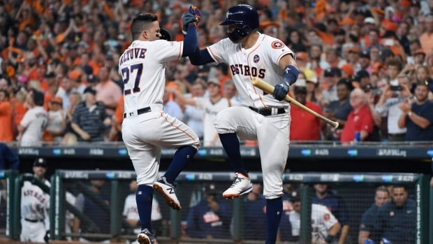 Houston's Jose Altuve celebrates his second of three home runs against the Boston Red Sox Thursday as the Astros took Game 1 of their ALDS.