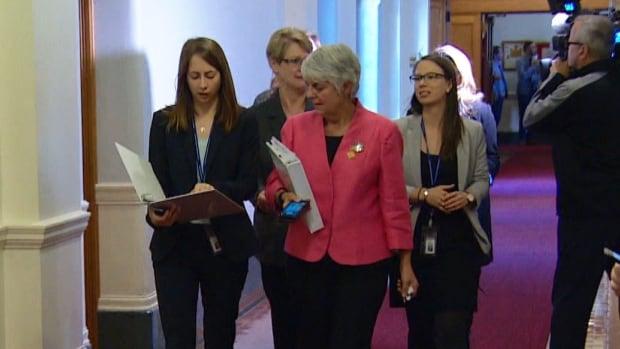 Finance Minister Carole James walks the halls of the B.C. Legislature on Thursday.