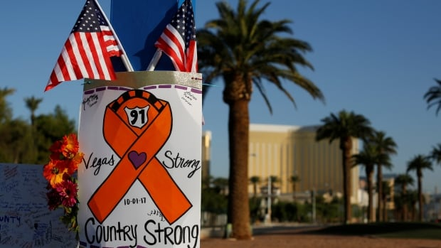 A sign is pictured at a makeshift memorial in the middle of Las Vegas Boulevard, following the mass shooting Oct. 4, 2017.