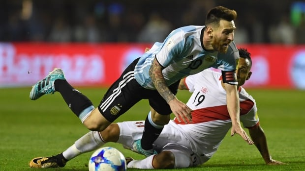 Lionel Messi, left, gets tackled by Victor Yotun during Argentina's 0-0 draw with Peru on Thursday. The result has knocked Argentina out of a World Cup spot with only one qualification game remaining.