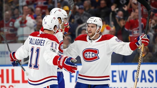 Montreal's Jonathan Drouin, right, celebrates Max Pacioretty's, centre, goal in the first period with teammate Brendan Gallagher in the Canadiens' 3-2 shootout win over Buffalo.