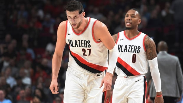 Portland Trail Blazers guard Damian Lillard speaks with centre Jusuf Nurkic during the first half of their preseason game against the Toronto Raptors in Portland, Ore., on Thursday.