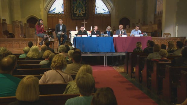 Candidates in the 2017 Vancouver byelection for city council prepare for the beginning of a forum on housing and homelessness on Oct. 5, 2017.